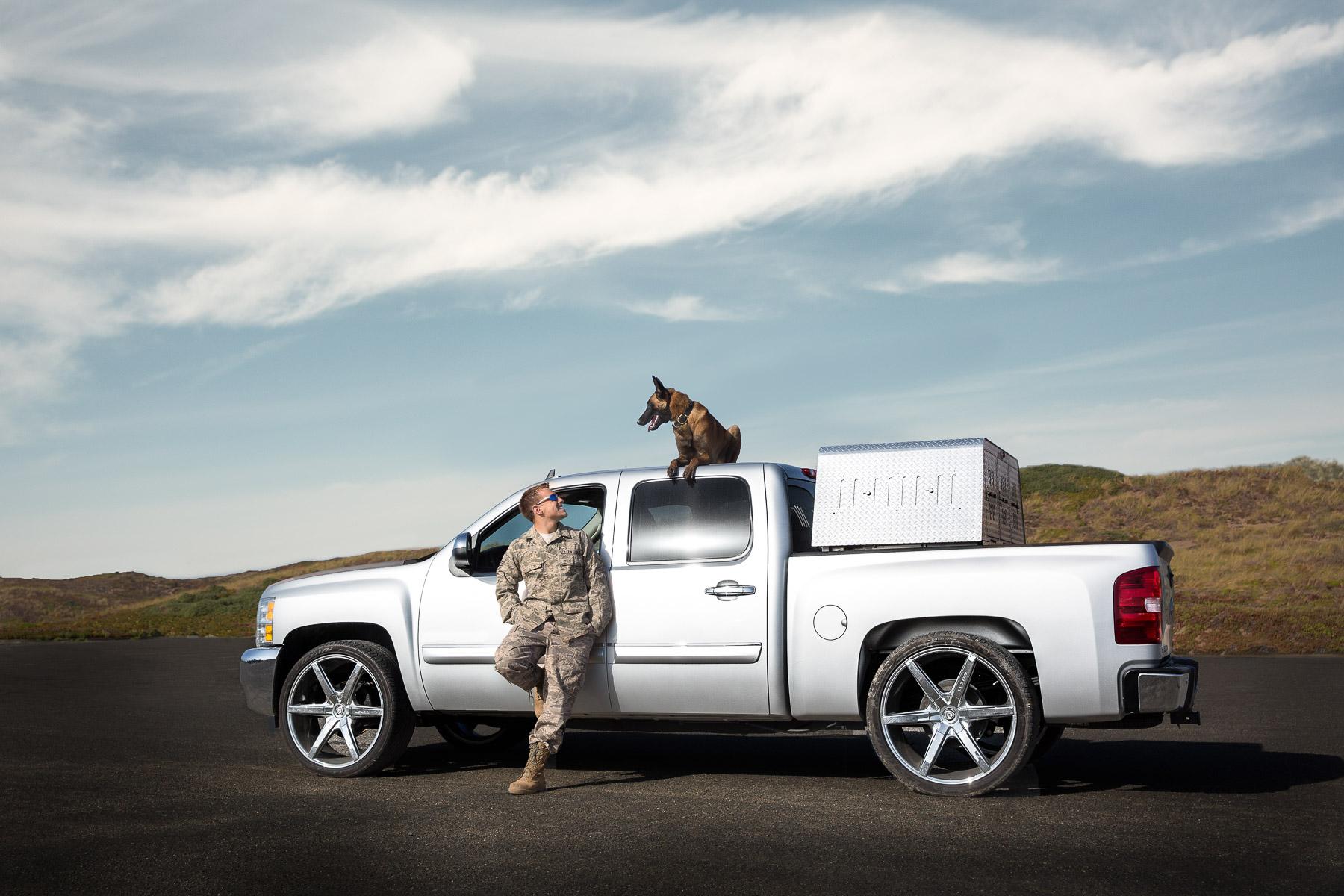 miliraty-man-with-dog-belgian-mallinois-dog-on-top-car-friendship-dog-photography.jpg