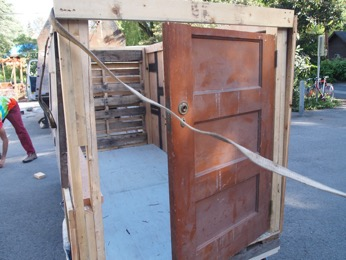 Pictured: House #2, built from scratch using cut plywood, cut door, and pallet on wheels.