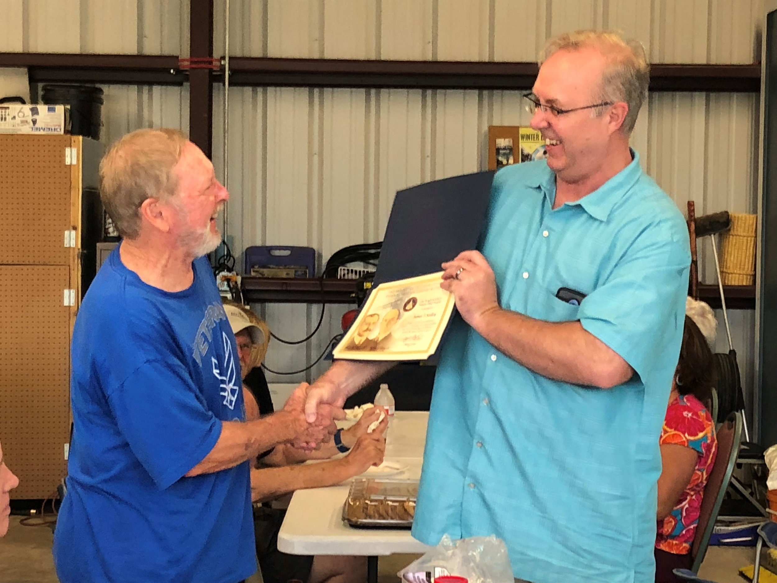 Jim Kelley (left) receiving the FAA Master Pilot award from Lance Little.