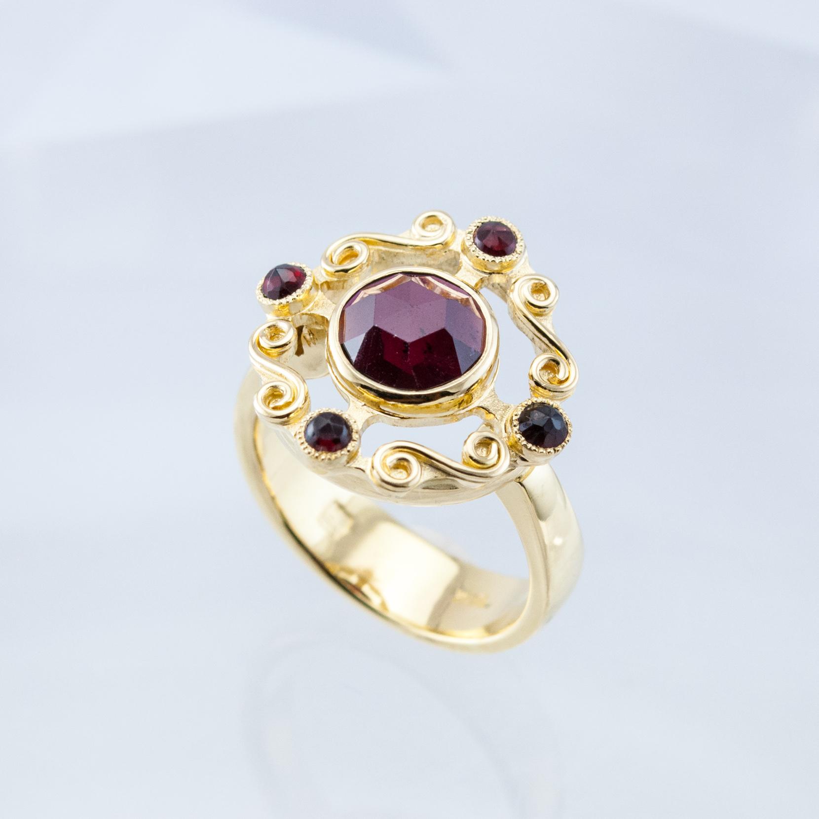 Spiral Crown Ring with Garnet