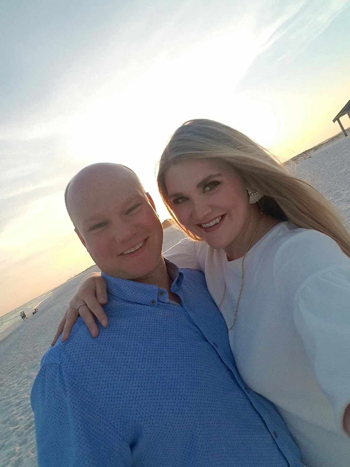 Jessi and her husband enjoying the sunset at one of their favorite beaches, Opal Beach in Pensacola, Florida.