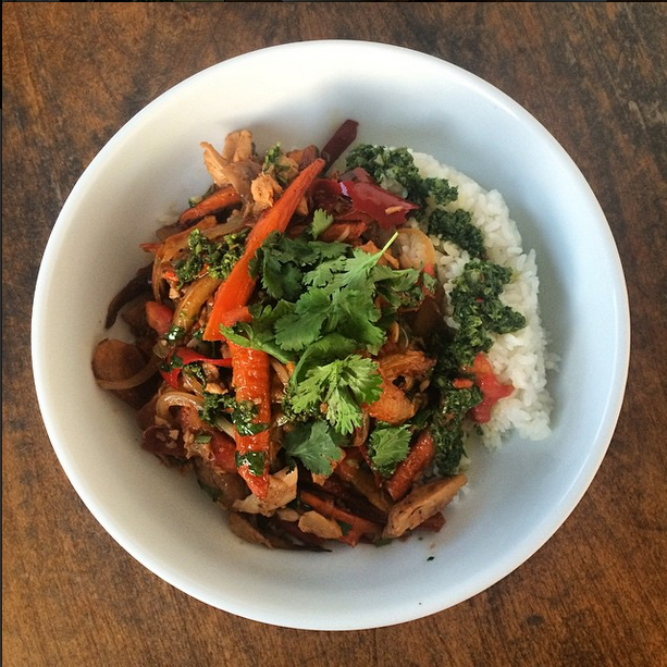 pollo saltado w/ fingerling potatoes, guajillo peppers, rainbow carrots + chimichurri