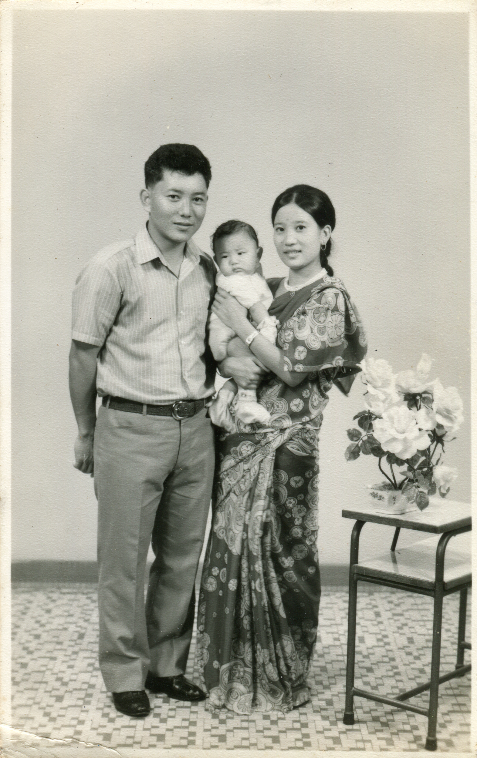 Studio portrait at a Paya Lebar studio. Arun Kumar Tamang with his wife, Meena Tamang and son – just 7 days old when this portrait was taken. By then, Arun has been in the Singapore Gurkha Contingent for close to eight years. Date: Sep 1972. Photo Collection: Aswin Tamang / SGPM.