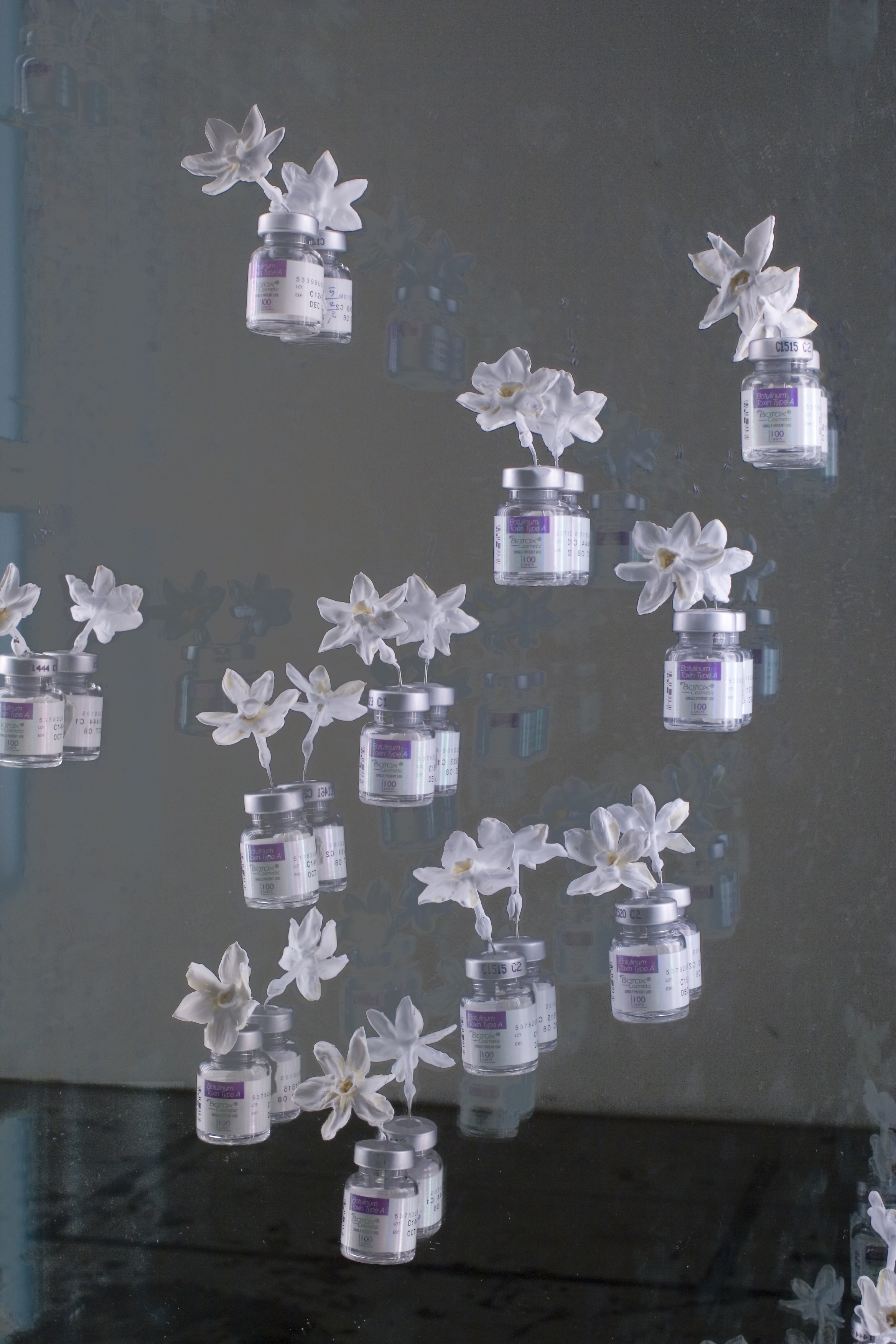 The Gaze I  (detail), 2007  Steel, glass, encaustic, narcissus flowers, Botox vials, fluorescents, plexiglass  73 x 30 x 6 inches