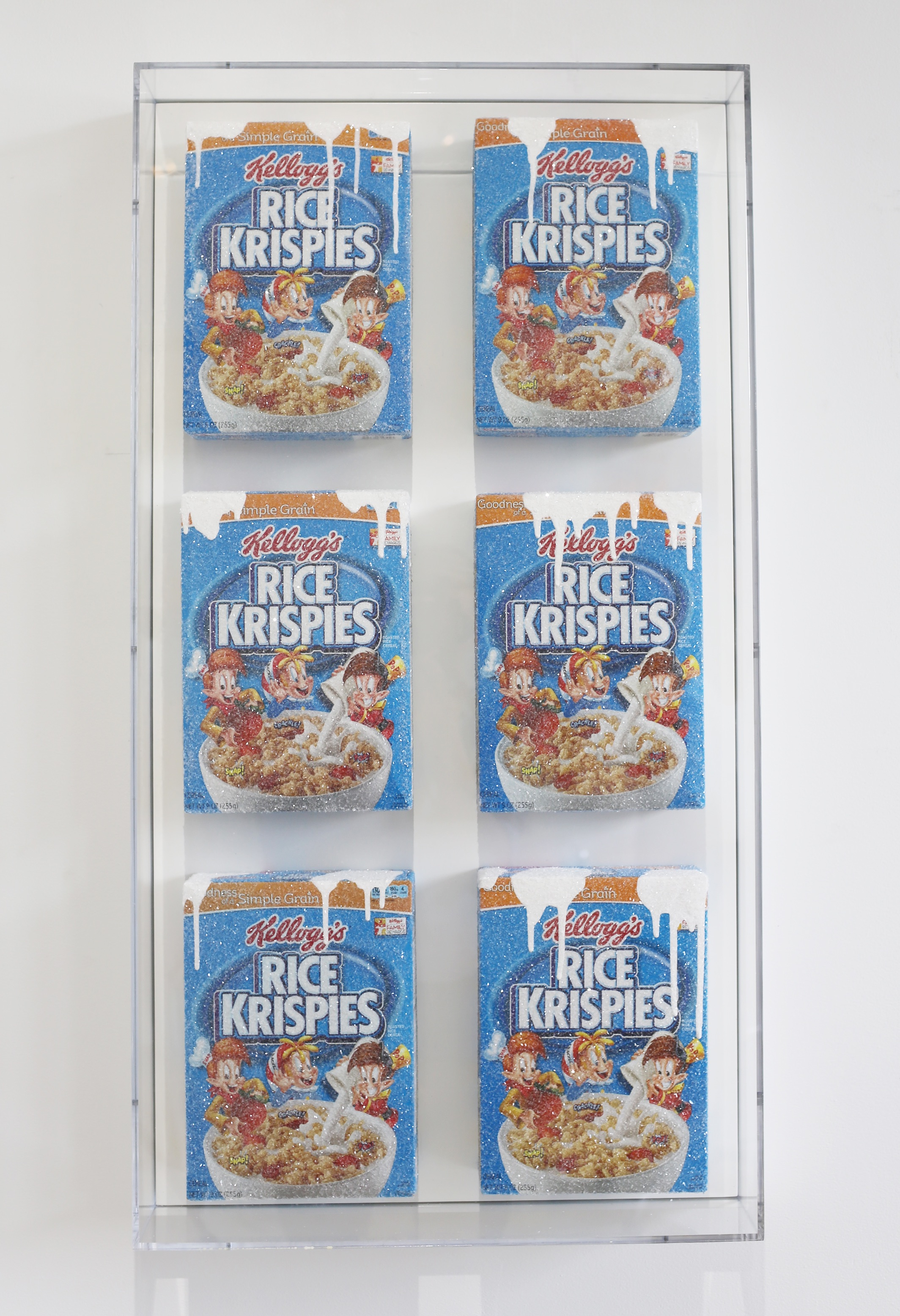 Snap, Crackle, Pop S , 2015  Cereal boxes, acrylic paint, crushed glass, plexiglass, wood  21 x 39 inches