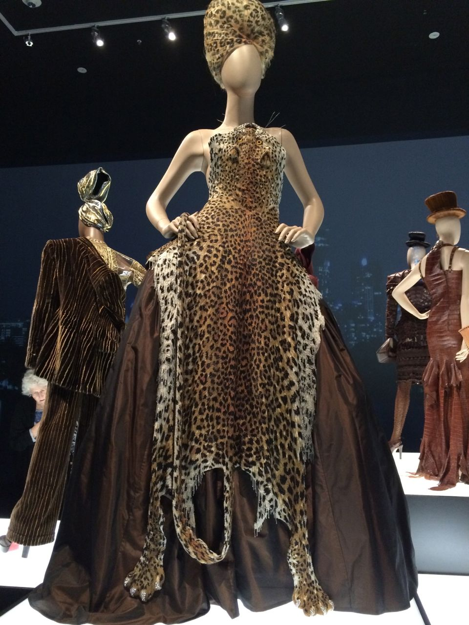 Amazing leopard dress. Love that leopard beehive! Photo by nazneenzainal.com