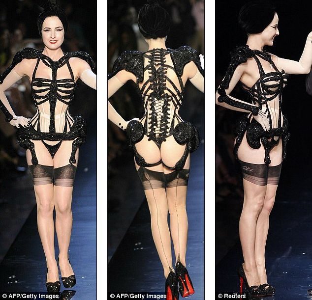 Dita von Teese in a sparkly skeleton corset number complete with thigh bone suspenders.