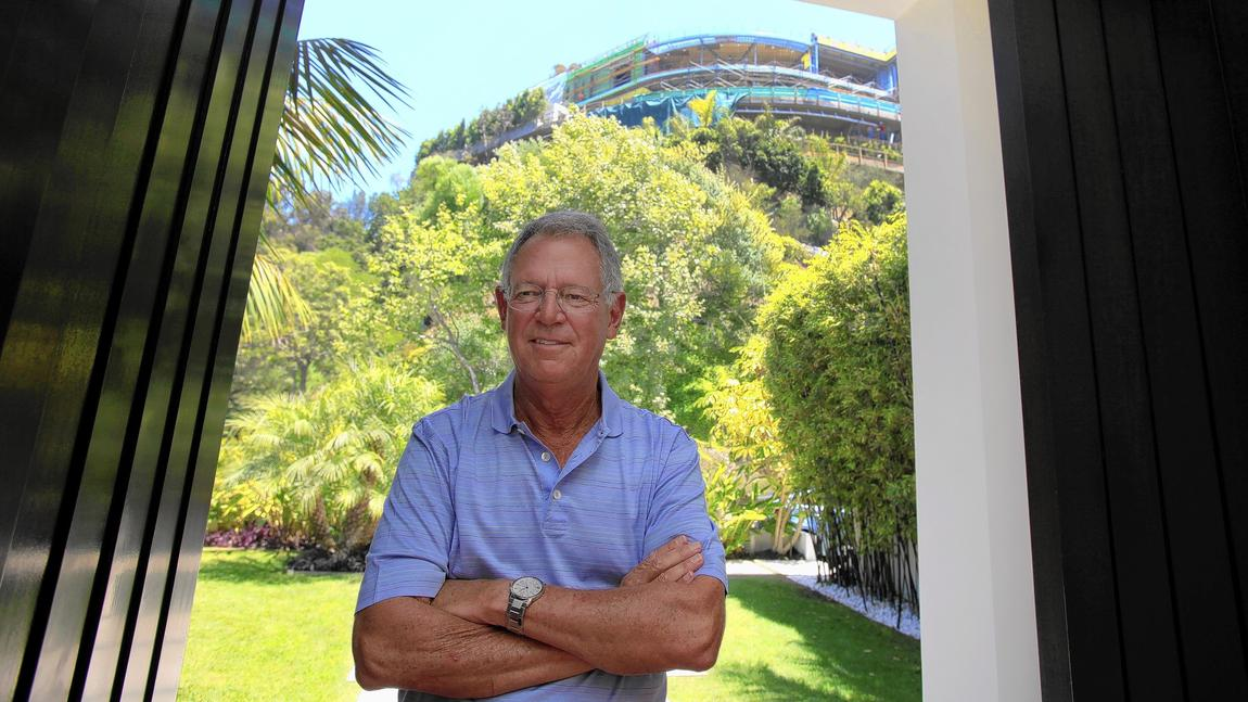 Joseph Horacek III, a veteran entertainment attorney, at the entrance to his Bel-Air home. (Francine Orr / Los Angeles Times)