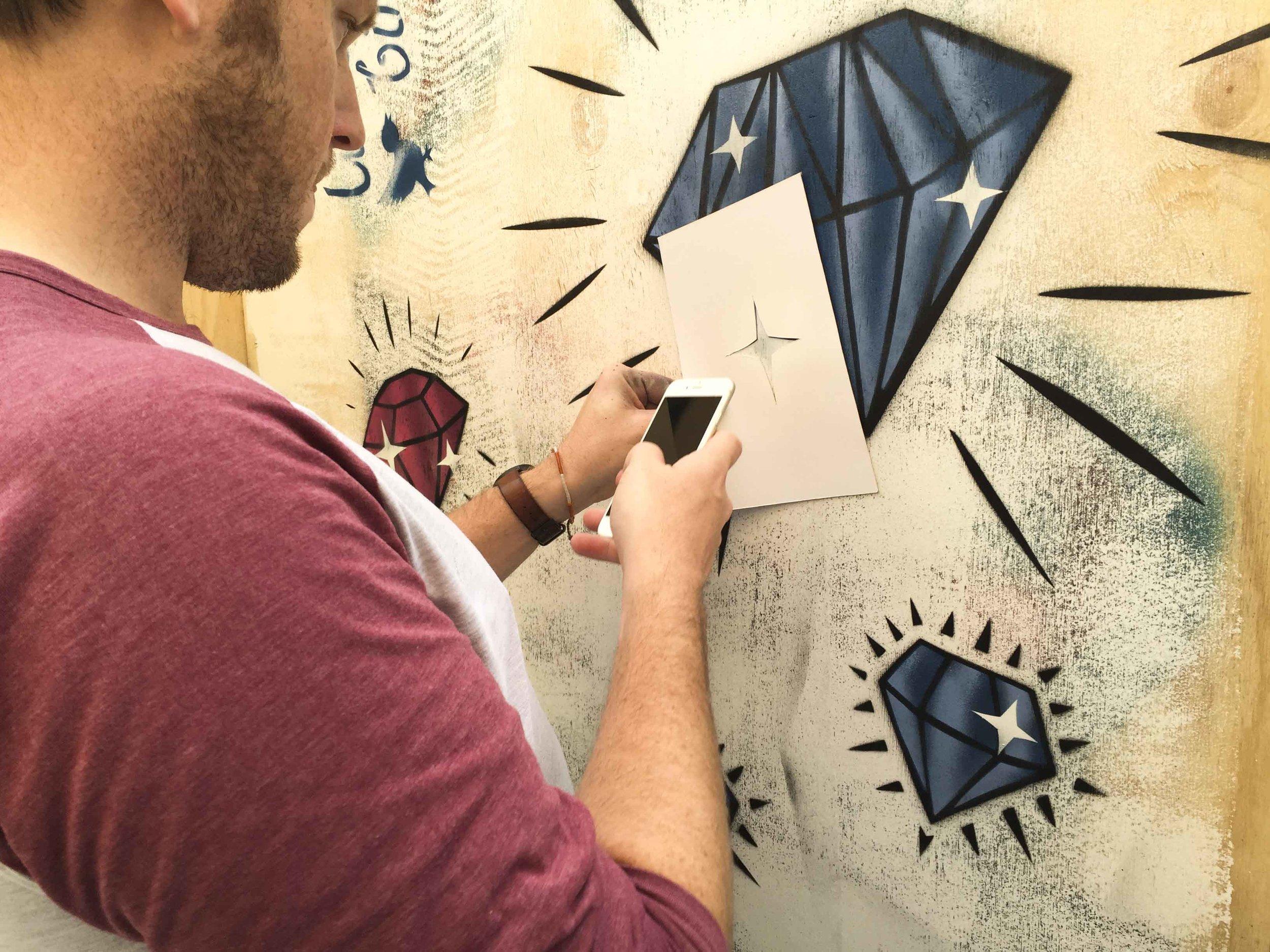 Tommo working on a stencil at Bendigo Street Festival