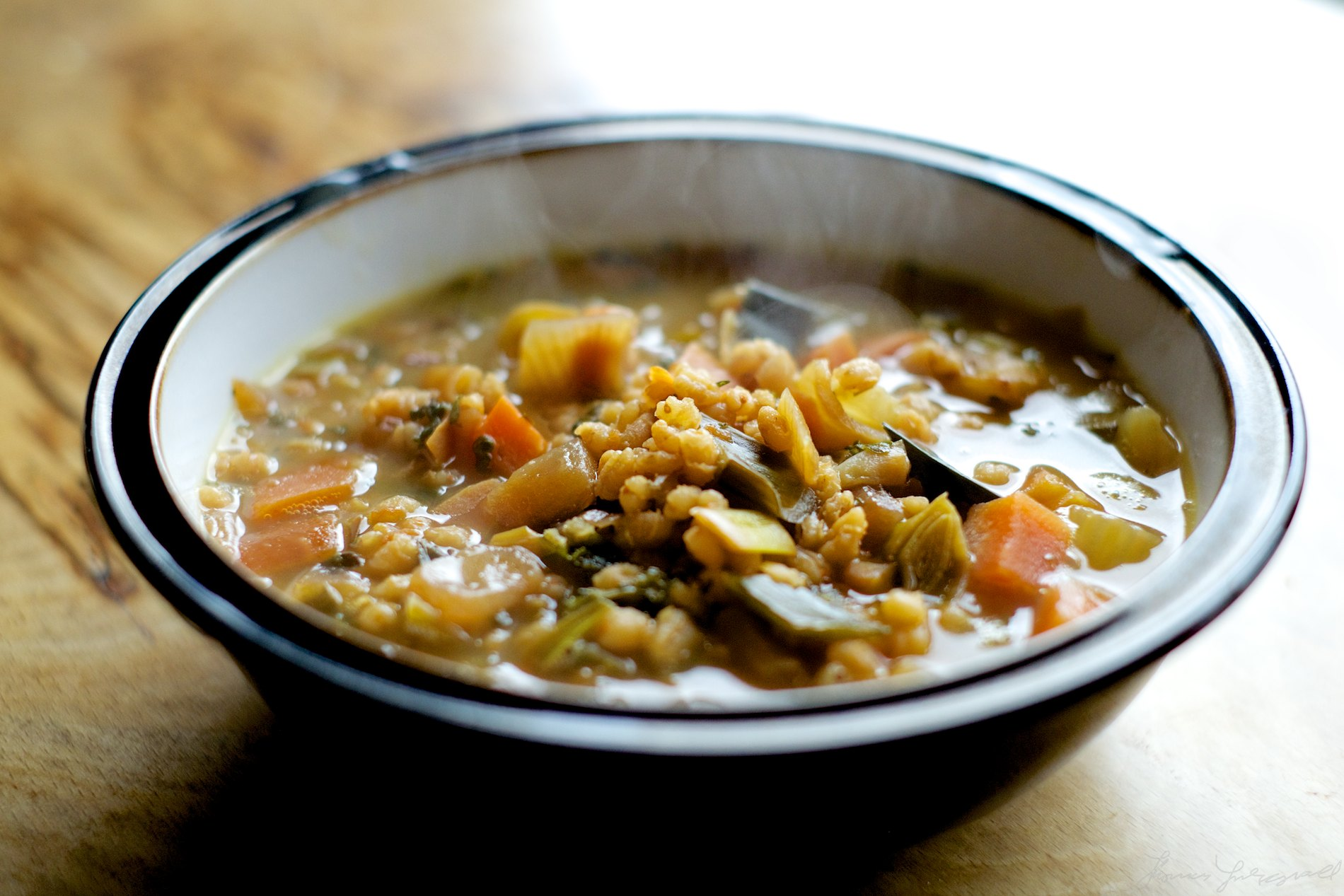 Soup in a bowl with steam rising
