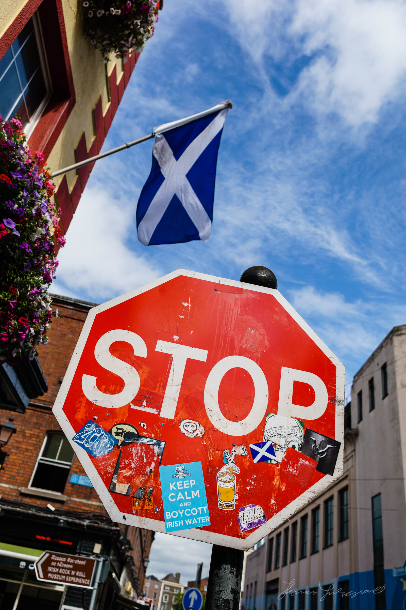 Street Sign in front of the Scottish Flag