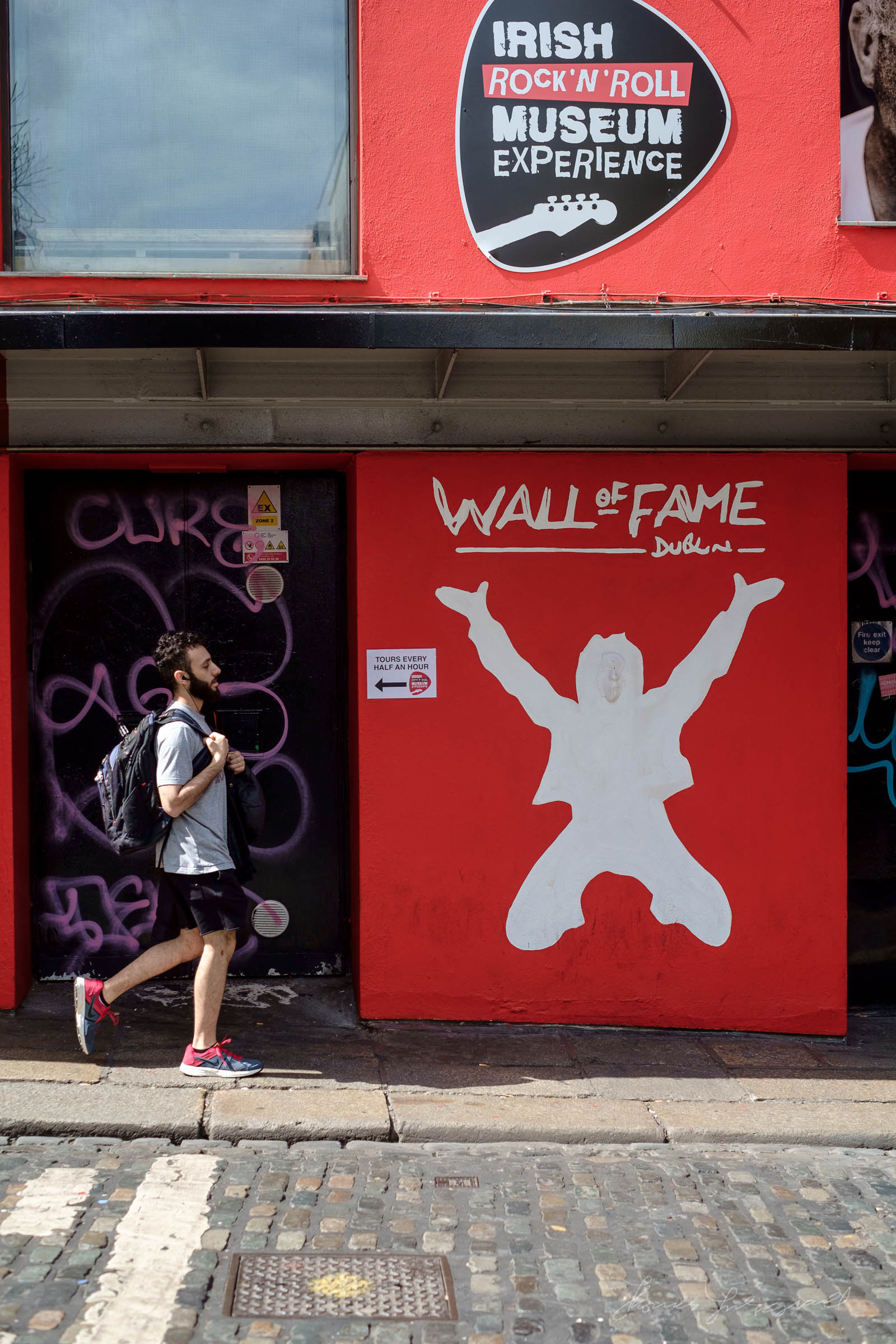 Walking by the Wall of Fame in Dublin's Temple Bar