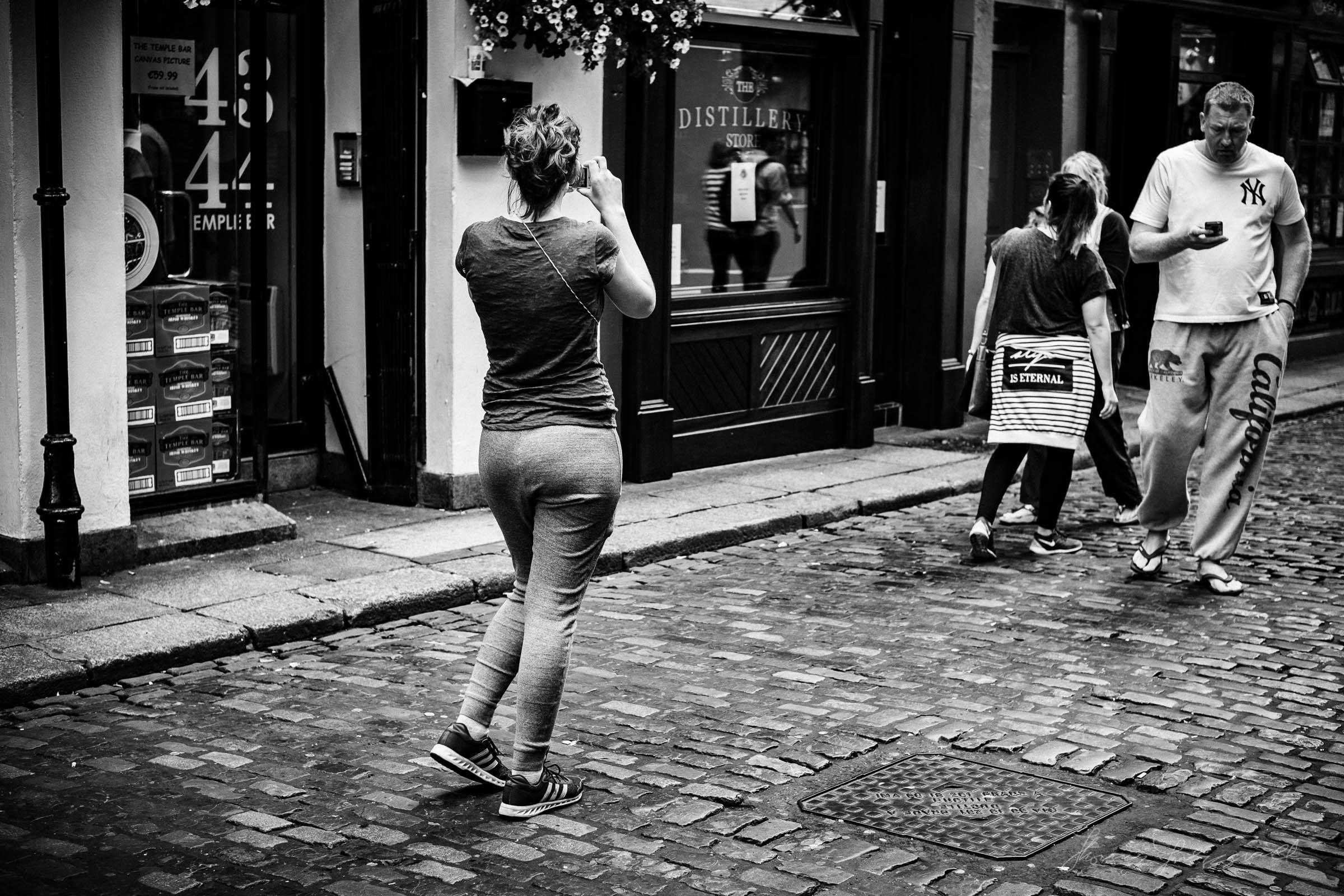 Tourist taking a Photo in Dublin's Temple Bar