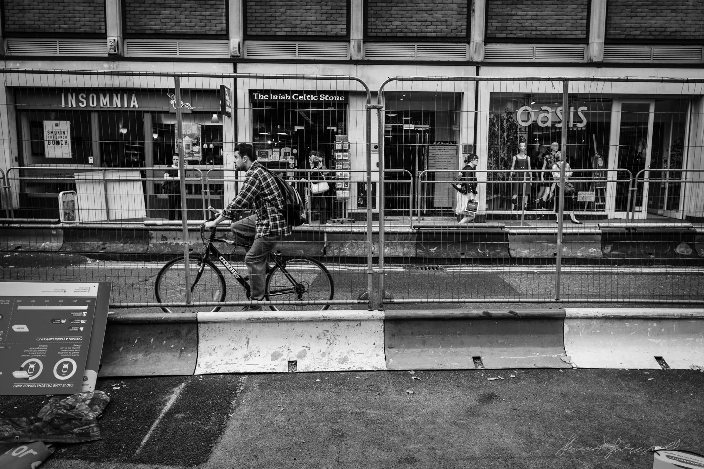 Man riding bike through the roadworks in Dublin