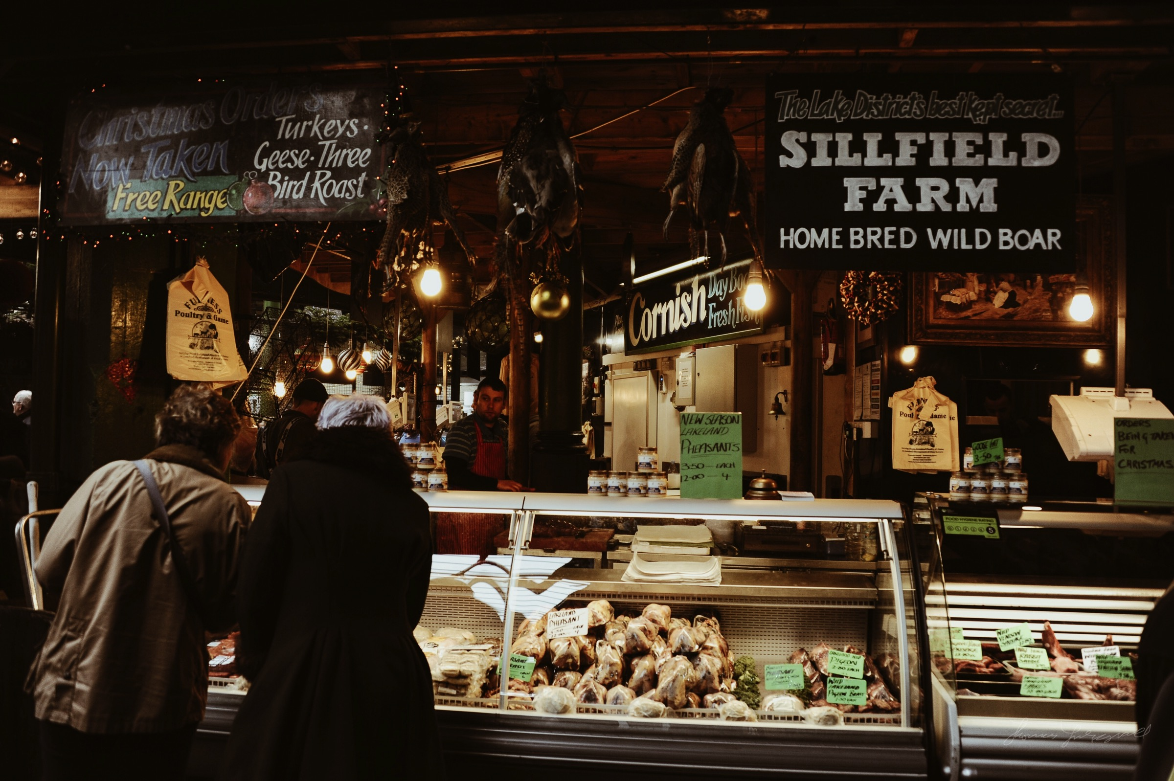 People at a butchers in the Borough market in London