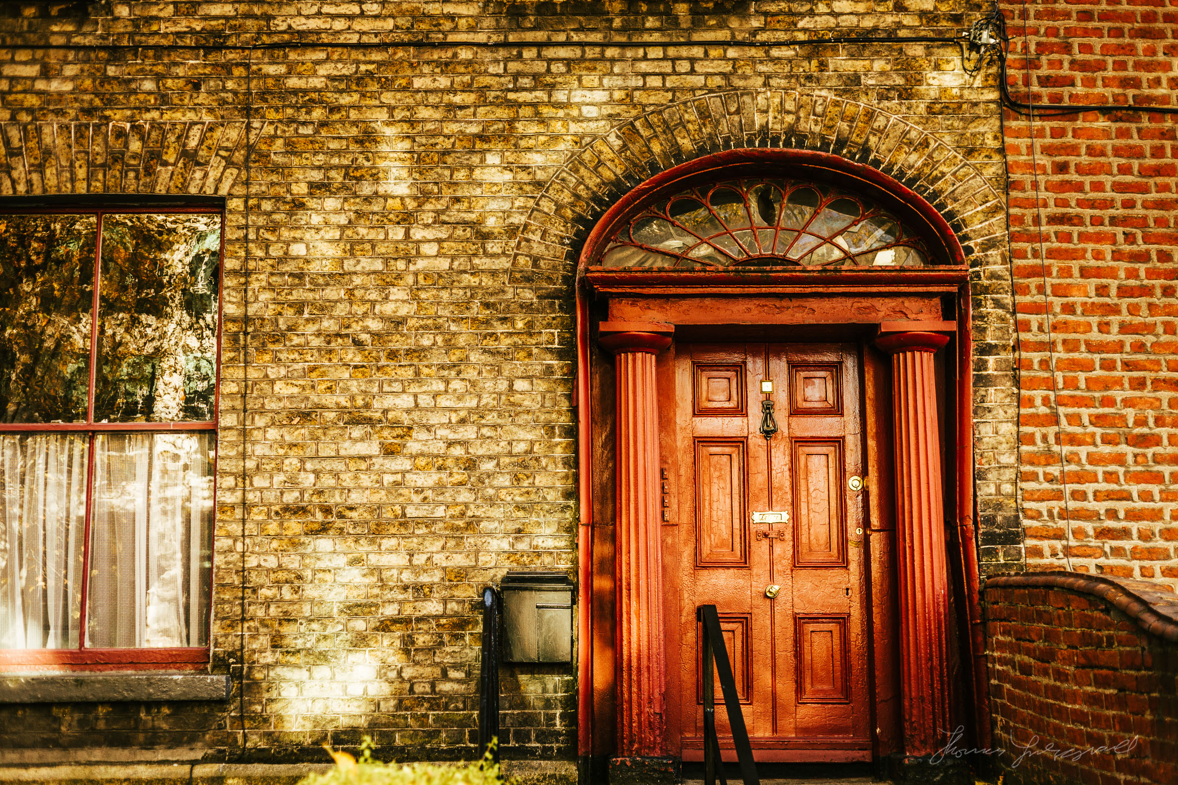 Red door on a brown brick house