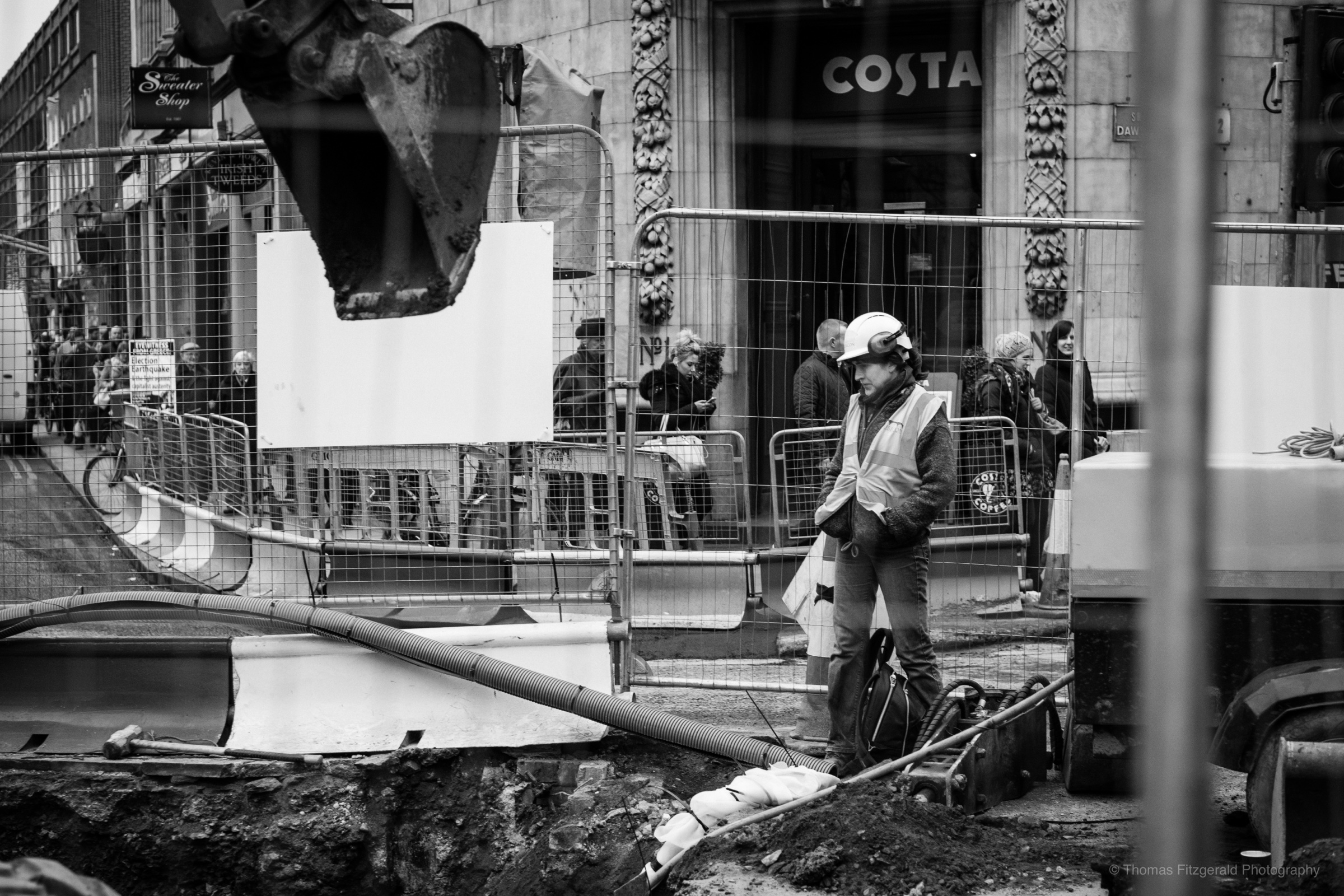 Construction worker examing the work in Dublin