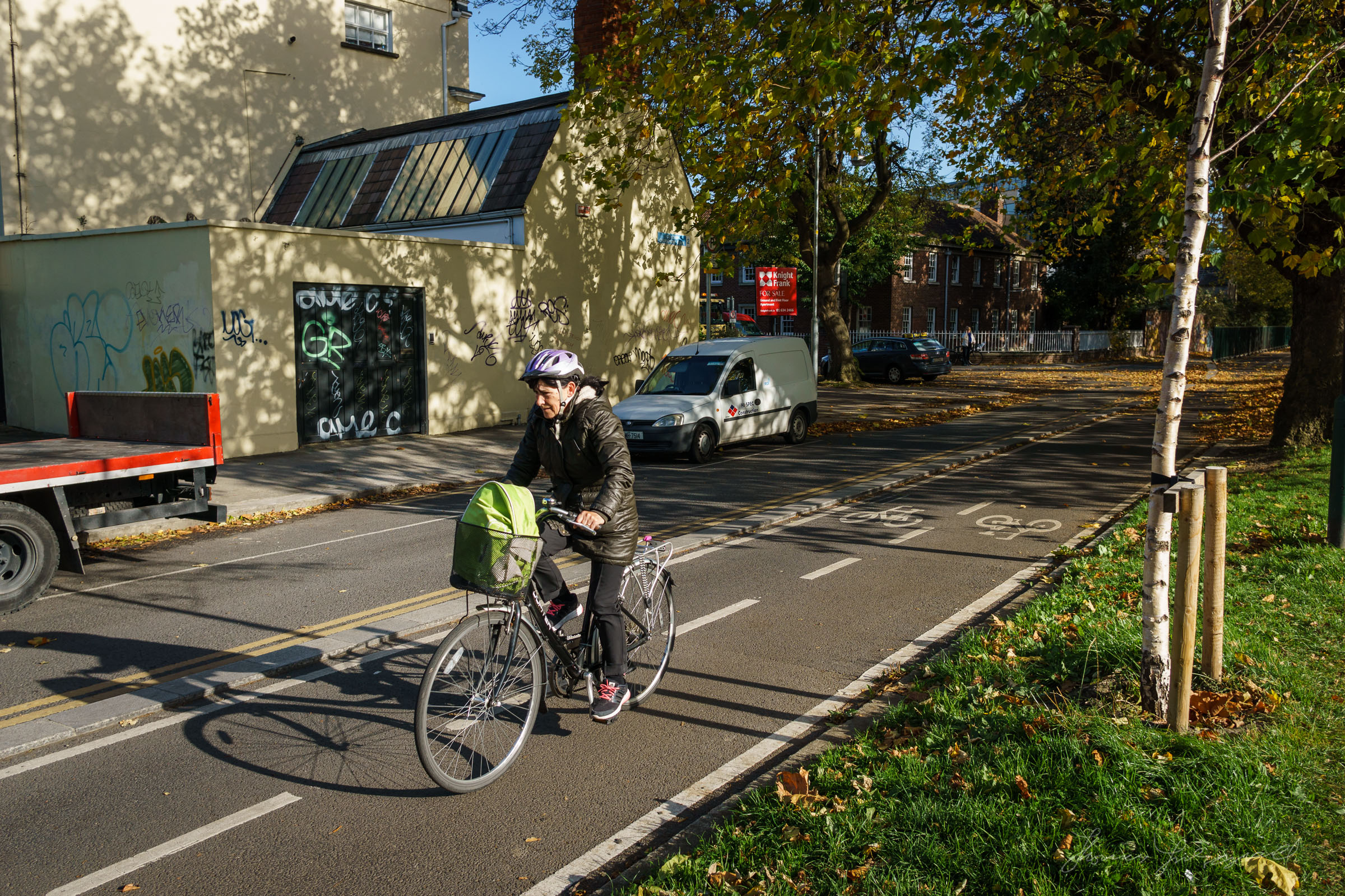 Woman cycling by the canal in Diblin
