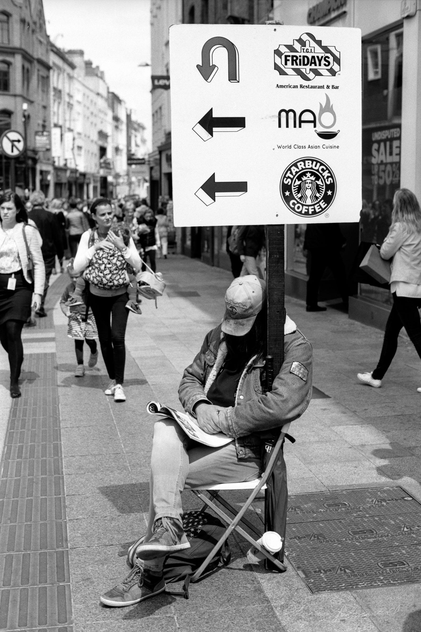 Guy-holding-sign-grafton-street.jpg