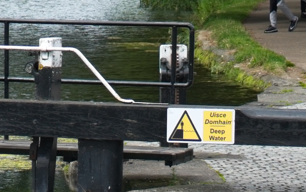 Stair stepping artifacts around the edges (Text on sign and bars over the wood on the lock gates)