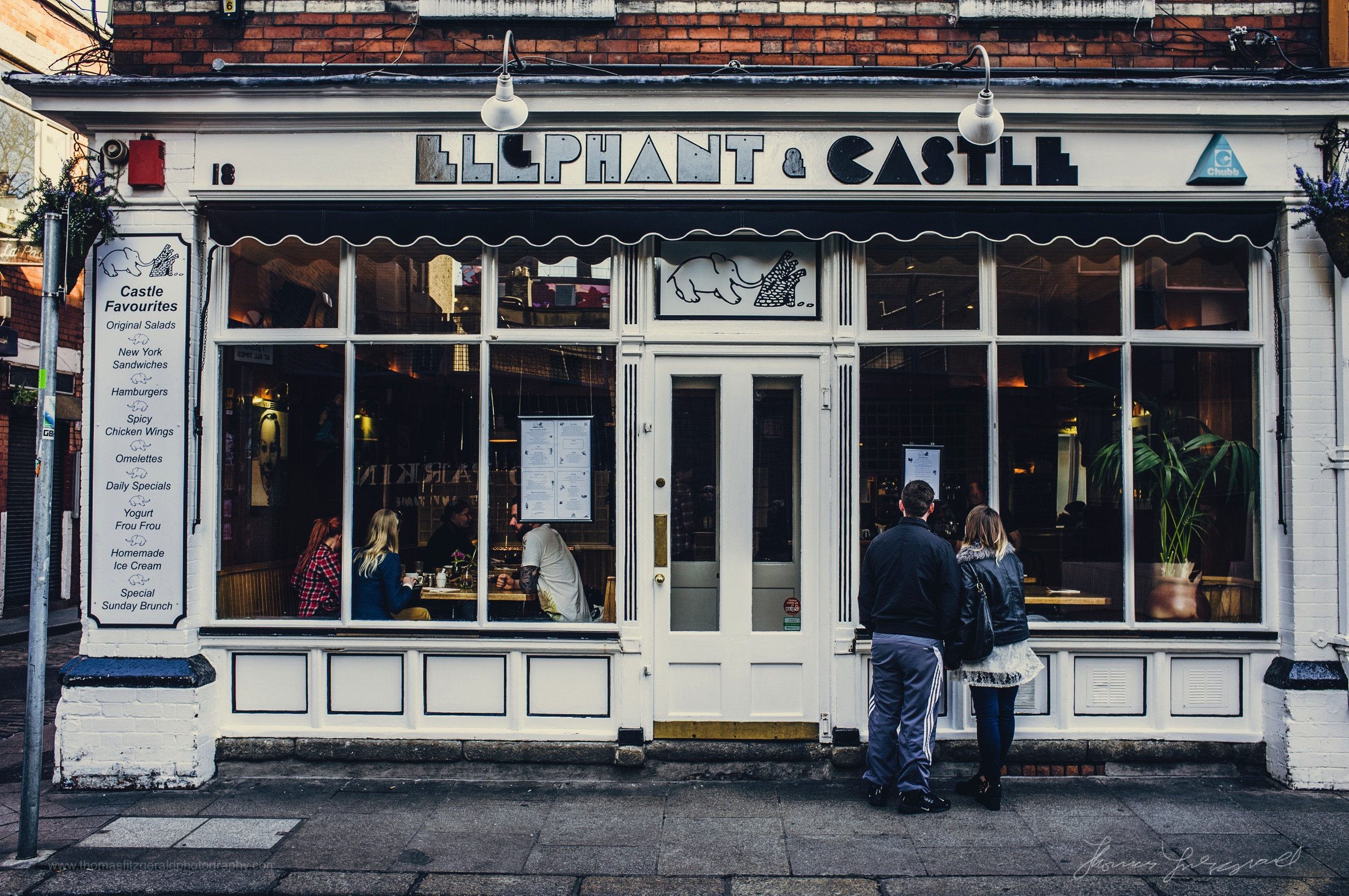 """People looking at the menu outside"""" The Elephant & Castle"""" in Temple Bar  ( One of my favourite Restaurants! )"""