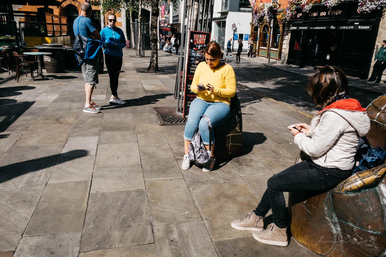 People on their phones in Dublin';s Temple Bar - Street Photogra