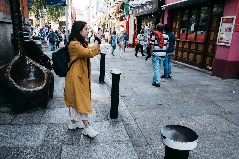 Girl taking a photo in Dublin's Temple Bar - Street Photograpy o