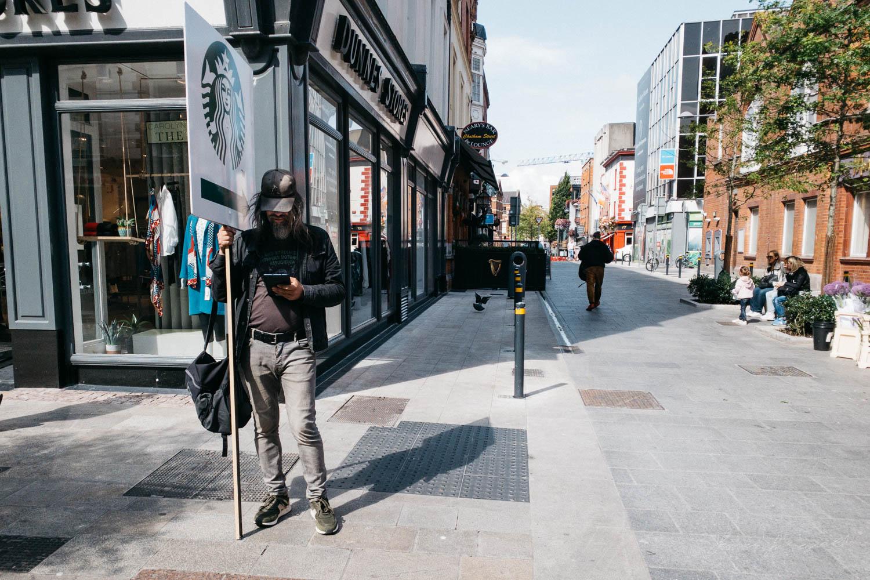 Sign holder on Dublin's Grafton Street - Street Photograpy on an