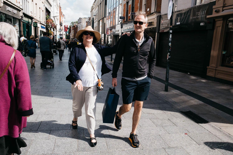 Couple walking down the street in Dublin City - Street Photograp