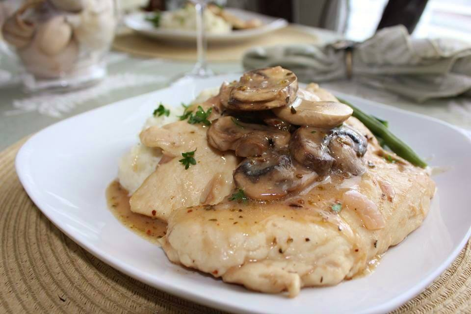 Chicken Marsala with mushrooms over garlic mashed potatoes.jpg