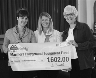 Leigh Nash and Jen Bennett of the Marmora Sno Fest Committee present a cheque in the amount of $1,602 to council at the October 7 meeting at Marmora Town Hall. Councillor Elaine Jones is shown with the presenters. The Sno Fest donation is to help with the Marmora Children's Park.