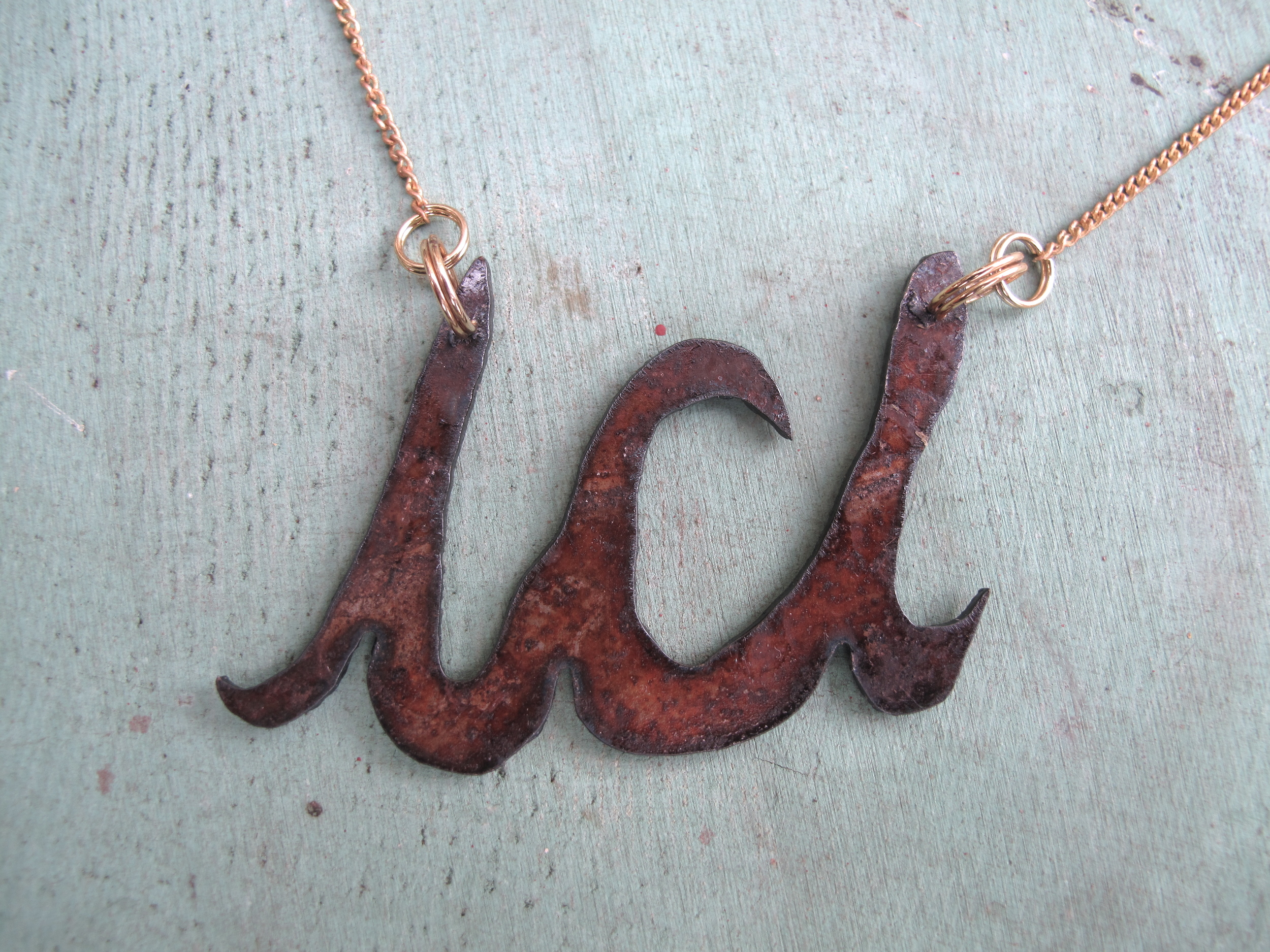 "Ici (""here"" in French) necklace. Plasma cut steel. *contact for customized bling."