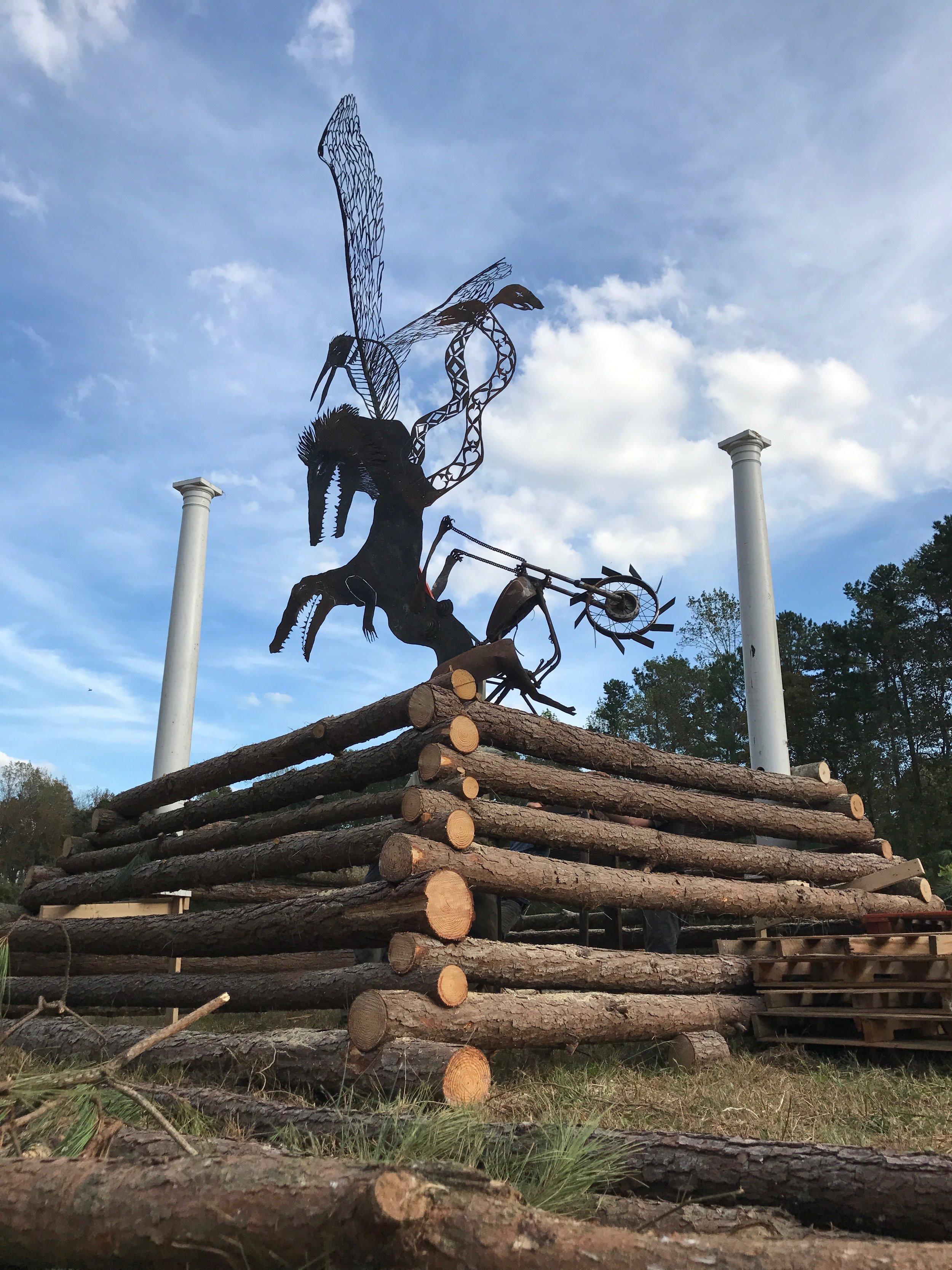 multi-headed beast effigy