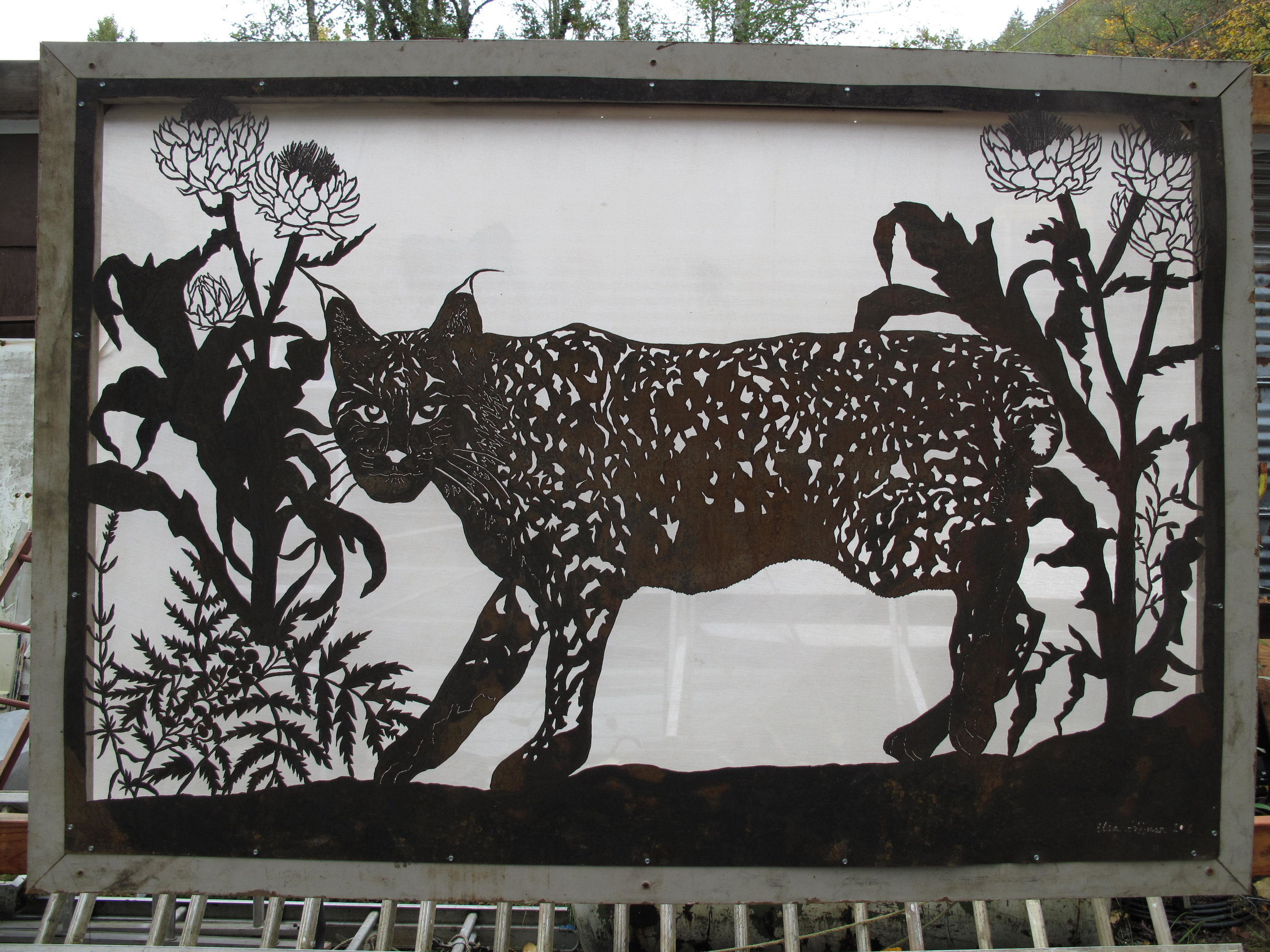 bobcat with artichokes