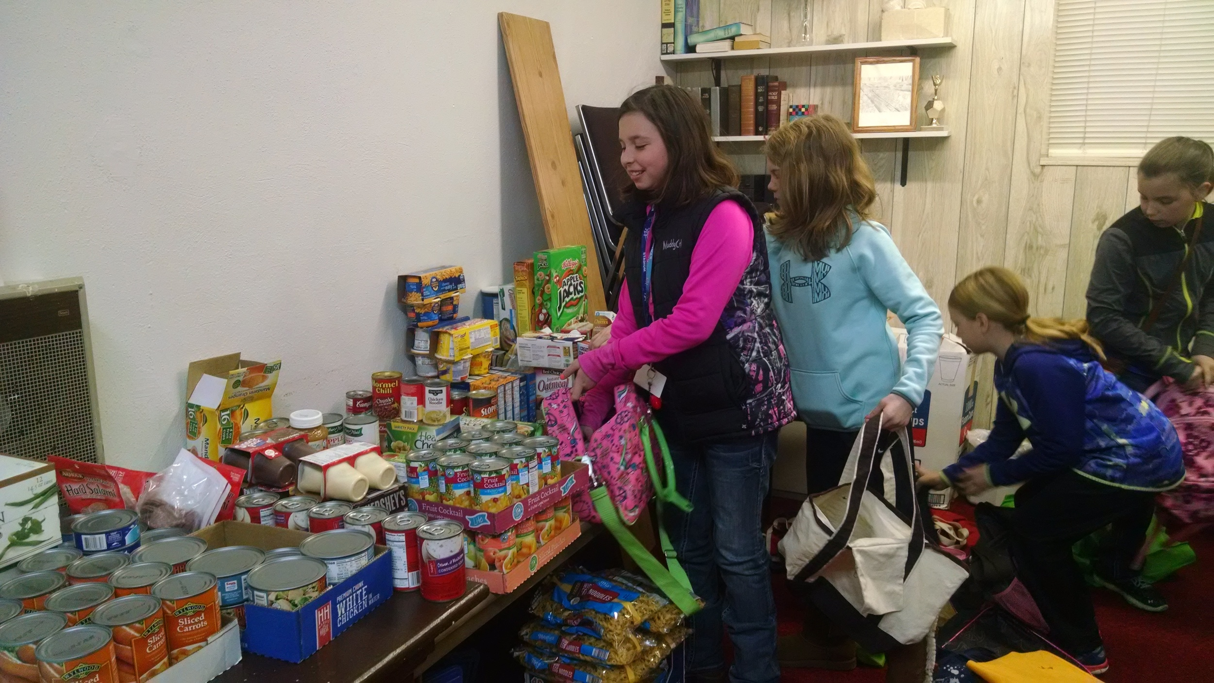 Youth of the church help pack the bags.