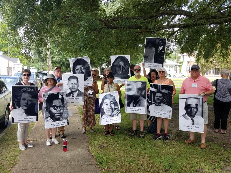 group with signs on lawn.png