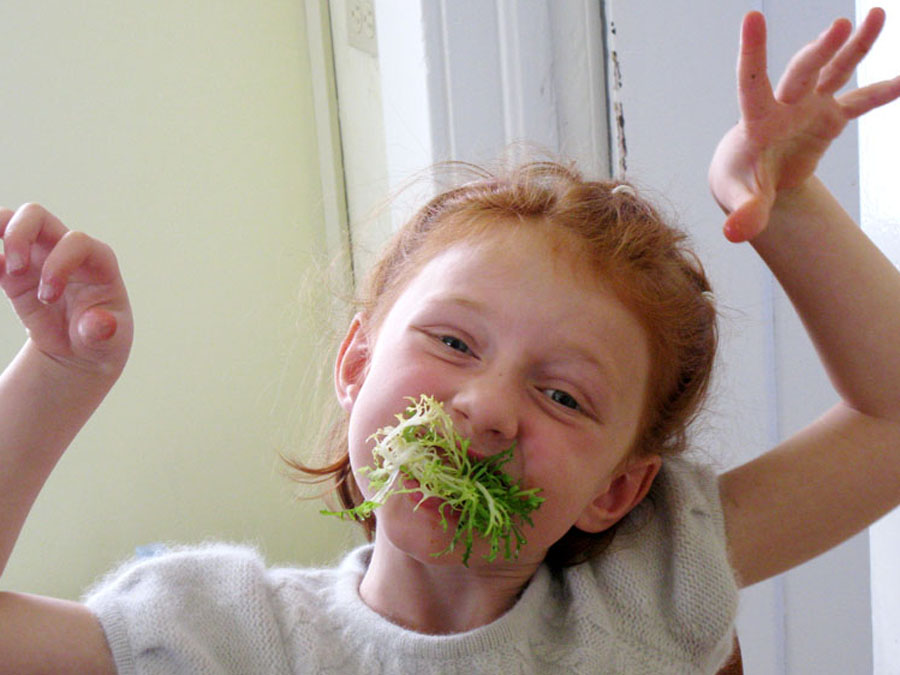 child eating lettuce