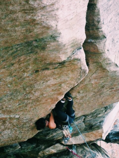 The initial invert moves on Bulletproof (5.13). Photograph byWayneBurleson