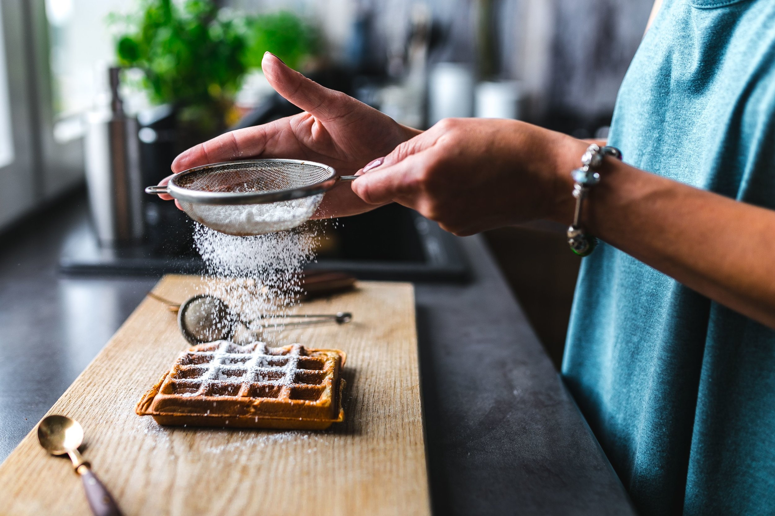 foodiesfeed.com_woman-pouring-sugar-over-her-waffle.jpg