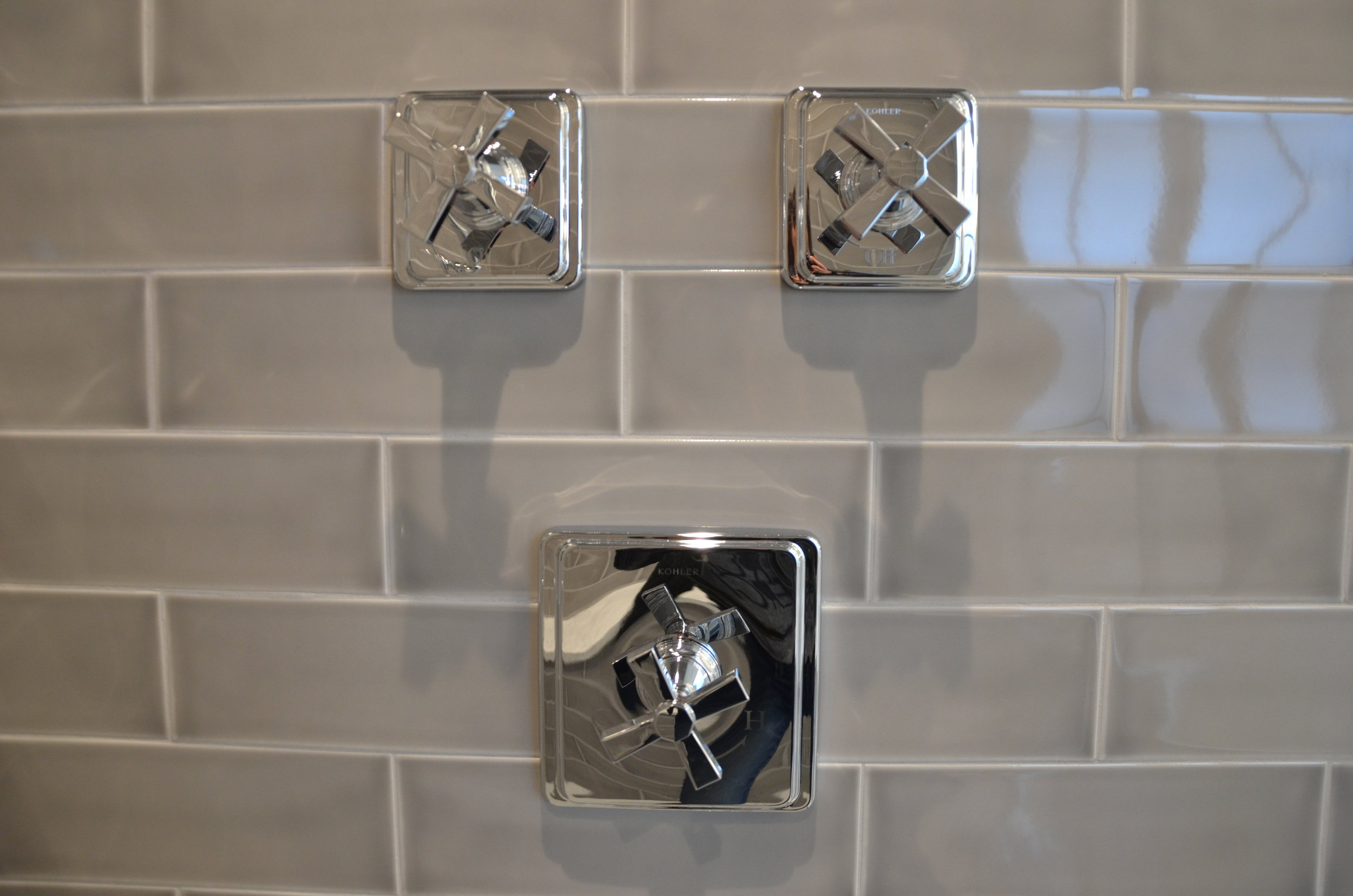shower faucets close up.JPG