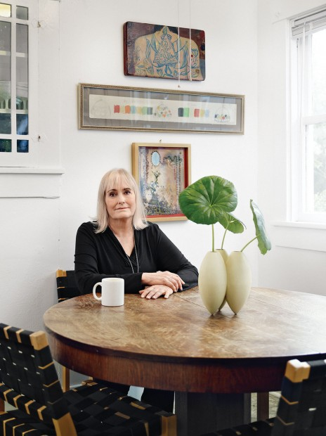 Judy Russell relaxes in their breakfast room at a sturdy antique oak pedestal table, from her family's home in Bellaire.