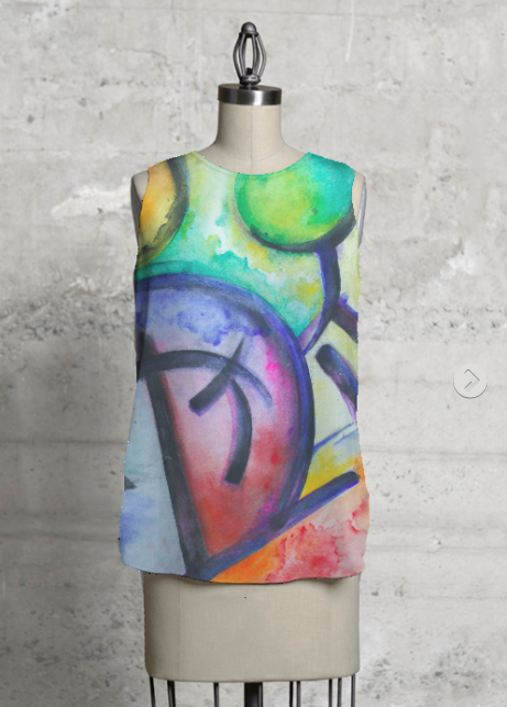 C'EST SI BON  Sleeveless Asymmetrical Shell     Click here to purchase   A portion of proceeds go to  Literacy for Life  via Shop Vida