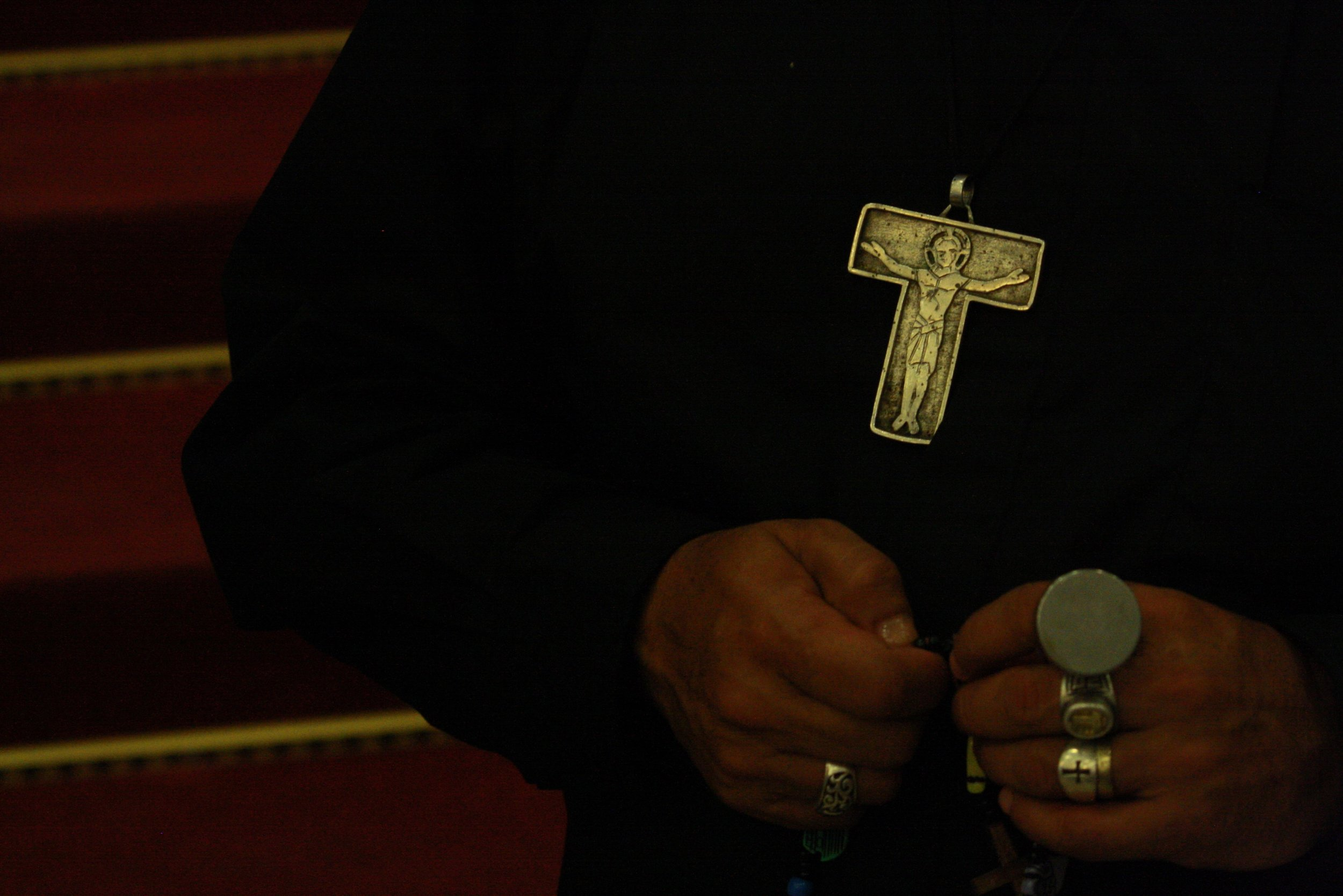 priest hands and cross.jpg