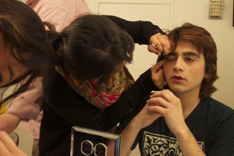 Make-up chairman Taylor Shennett helps Daniel Jaramillo get ready for one of the final dress rehearsals.