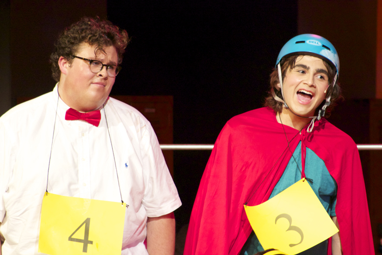 Barfee and Coneybear help sing a competitor offstage.