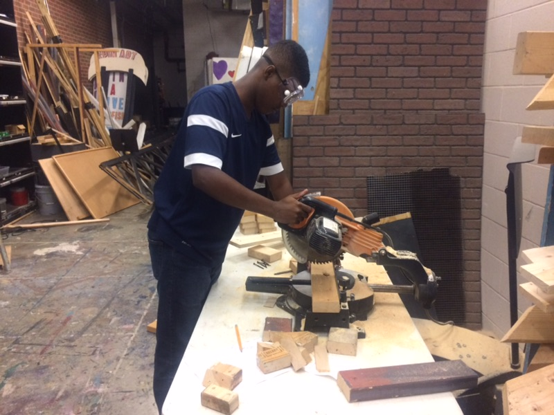 Master Carpenter Jason Harris cuts wood for the set of  Is He Dead?