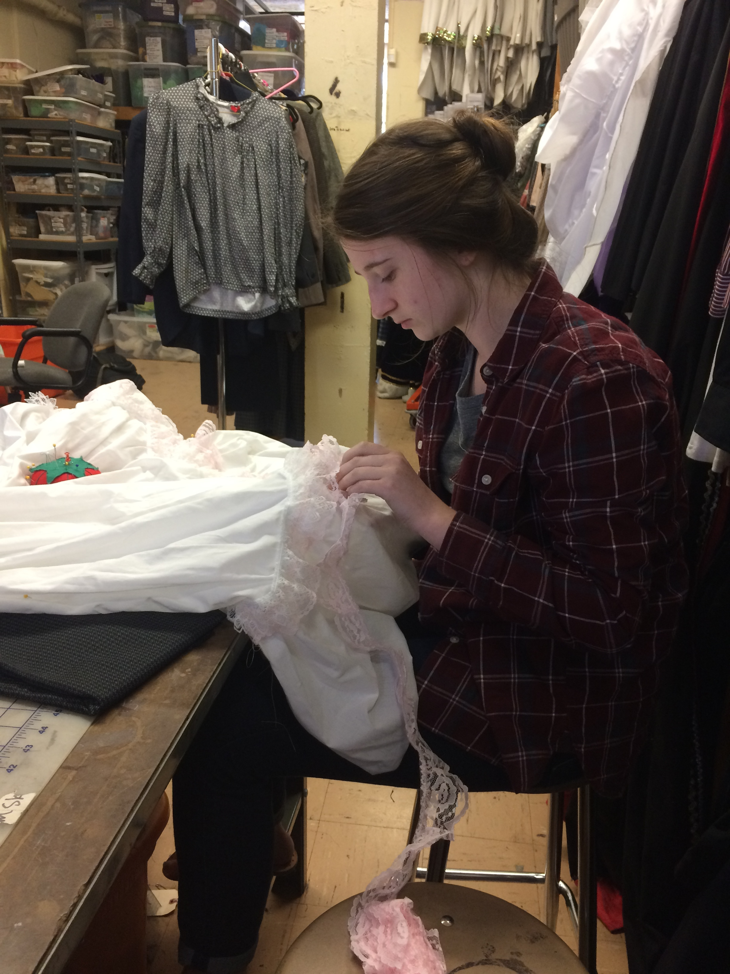 Costume Chairman Avery Moore pins meticulously adds details to a petticoat