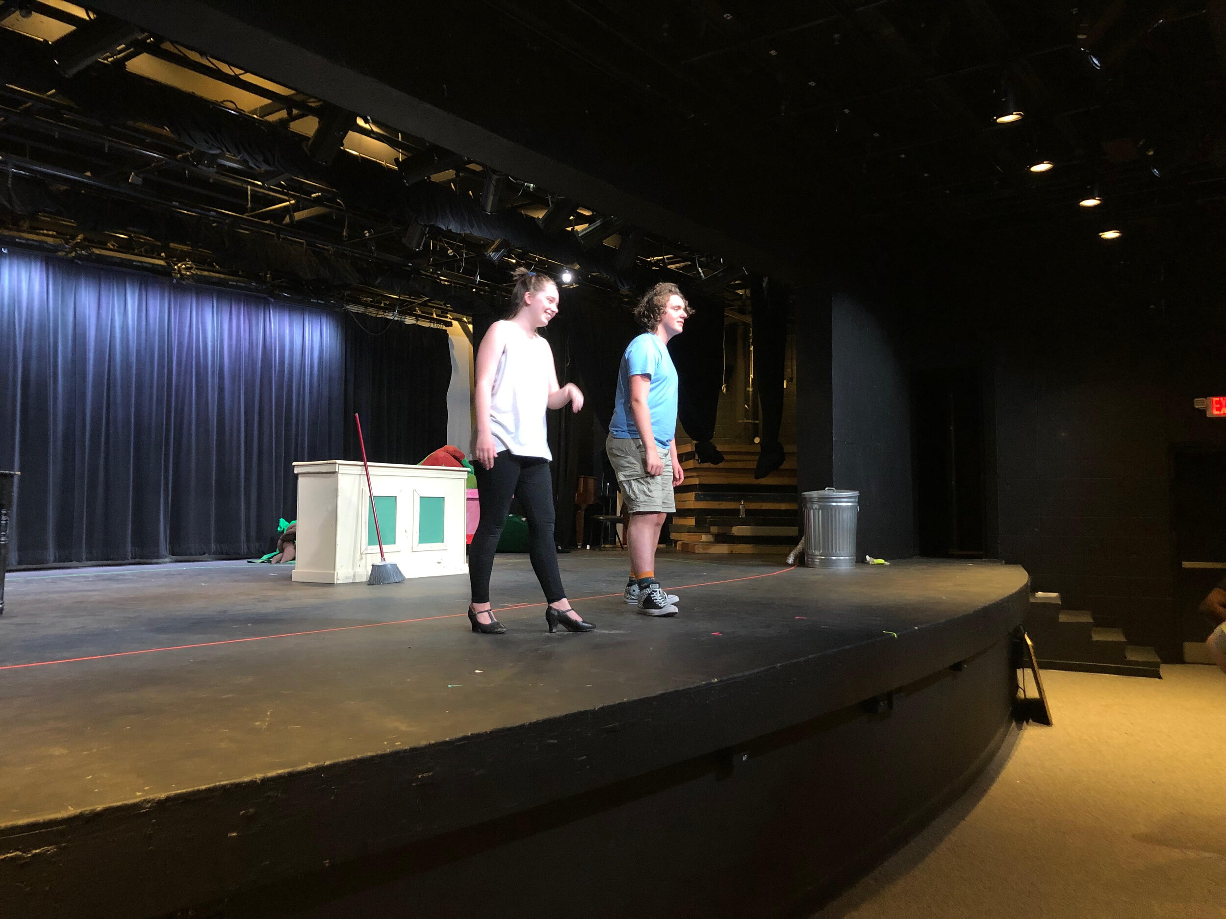 Kaitlyn Poindexter (Audrey) and Andrew Heady (Seymour) are on stage having a blast at rehearsal.