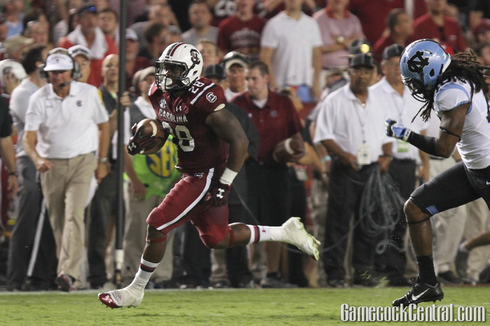 Sophomore tailback Mike Davis broke off this 75-yard touchdown run on South Carolina's first offensive play of the first quarter, giving the Gamecocks a healthy 27-10 lead.