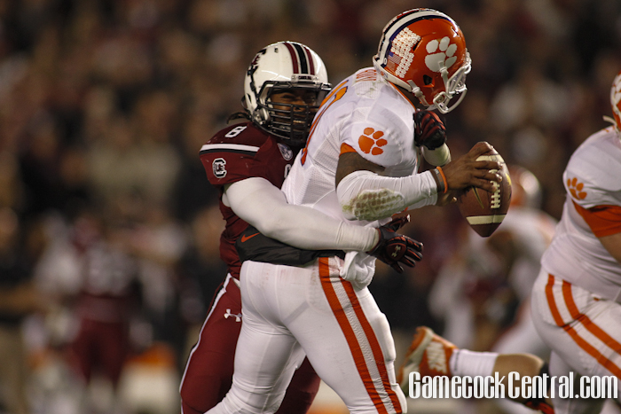 Staff photo by Chris Gillespie. LB Kaiwan Lewis sacks Tajh Boyd.